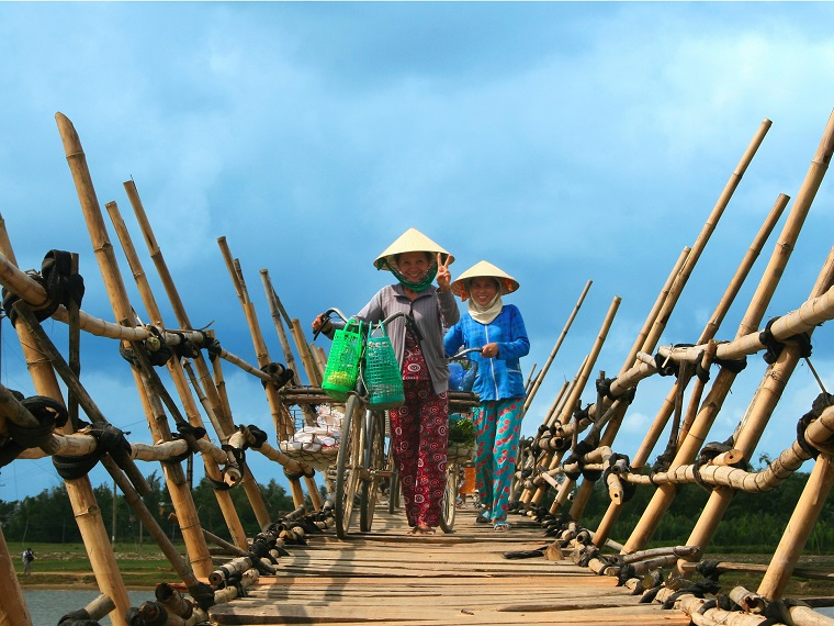 Bamboo bridge over Truong Giang river (Hoi An, Vietnam)